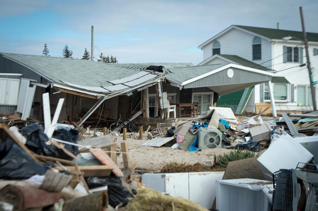 Damaged house an storm debris.