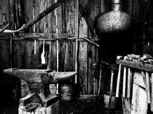 Old iron anvil in a rough wooden barn. Photo by Gabino Iglesias.