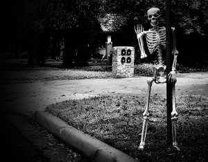 Skeleton hanging on a street sign. Photo credit: Gabino Iglesias,