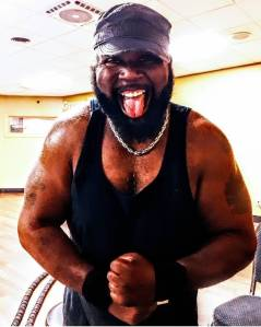Shawn Cosby flexing after a workout.